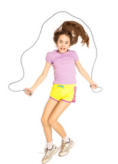Isolated photo of smiling girl jumping with skipping rope