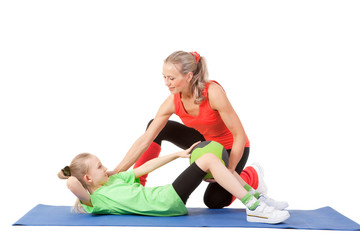Little girl doing exercise with an instructor