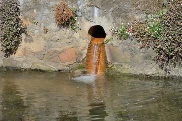 drain sewage into a river