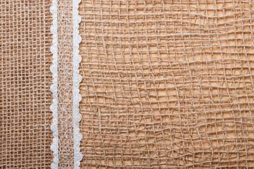 Lace ribbon on burlap cloth background