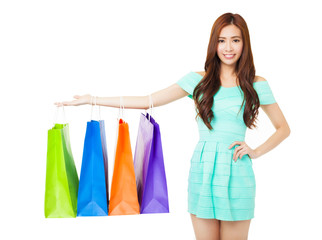 young woman showing the shopping bags isolated on white