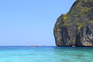 Maya Bay lagoon with Motor boat on turquoise water