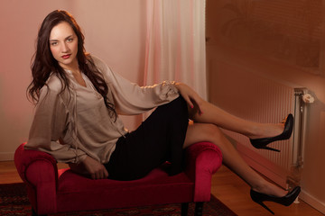 Reclining woman, indoor portrait