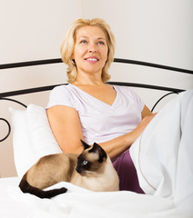 mature woman with kitten