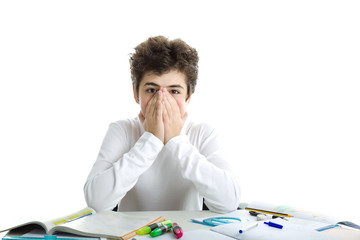 Caucasian smooth-skinned boy on homework hiding face with hands
