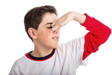 Caucasian smooth-skinned boy plugging his nose