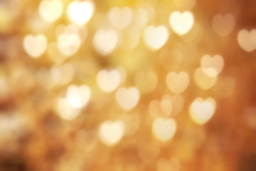 Golden heart symbol bokeh