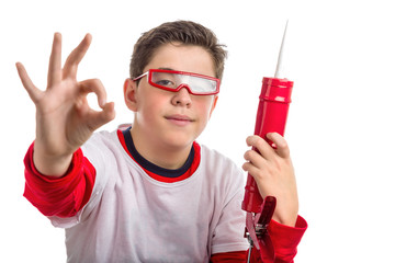 Caucasian smooth-skinned boywearing red goggles and holding a ca