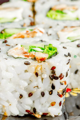 rolls with sesame seeds close up vertical picture