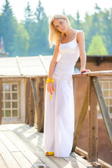 beautiful young blond woman in white skirt