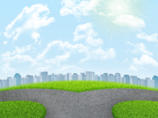 Road fork, green grass field and city. Sky with clouds