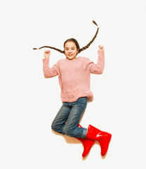 Isolated photo from top of happy jumping girl in red rubber boot