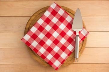 napkin at cutting board on wood