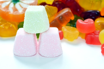 Triangle of sour jelly pink, orange and white candy