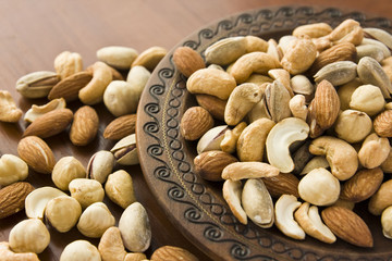 Mix nuts in wooden plate