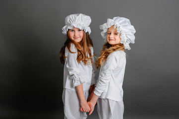 girls clothing rustic vintage on a gray background holding hands