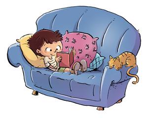 niño leyendo en sofa