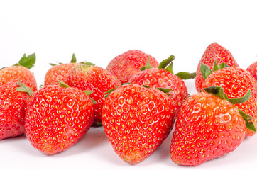 Close up group of red strawberries isolated on white background