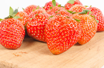 Group of strawberries on wooden board  isolated on white backgro
