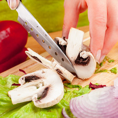 cutting mushroom champignon