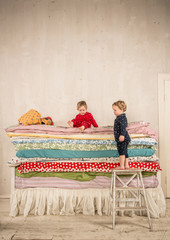 Children on the bed - Princess and the Pea.