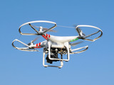 Drone quadcopter with digital camera in flight. poster