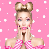 Fototapety Beauty model girl with bow hairstyle over polka dots background