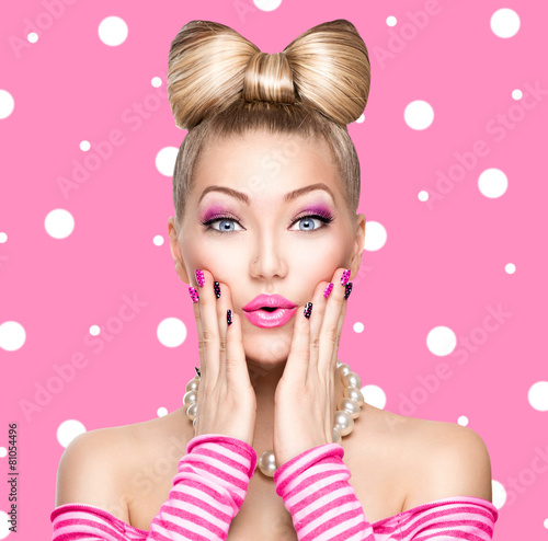 Beauty model girl with bow hairstyle over polka dots background - 81054496