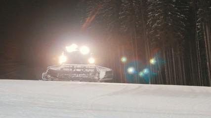 Snowcat works at the ski slopes