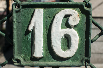 Old retro cast iron plate with number 16 on it