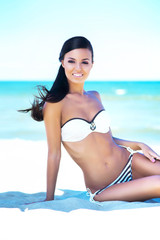 Gorgeous young girl on a summer beach