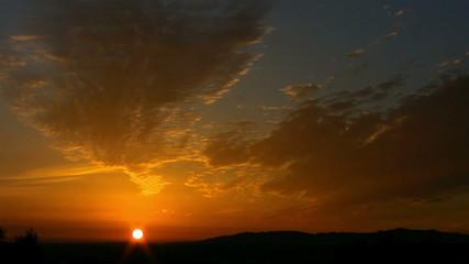Setting sun on the horizon timelapse