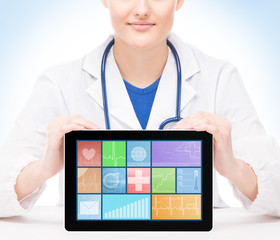 Young and professional woman doctor with an ipad isolated on whi