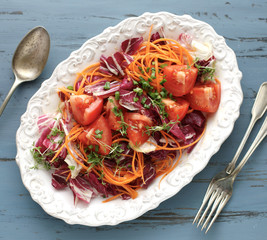 Fresh salad with radicchio, carrots and tomatoes