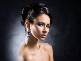 Young, beautiful and rich woman in jewels