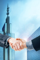 Business handshake on a city background