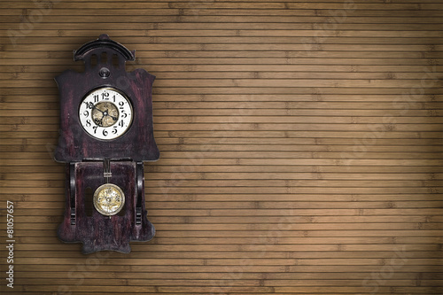 Tuinposter Retro old pendulum clock on the background of wooden wall