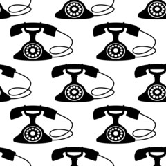 Seamless pattern with retro telephone silhouettes