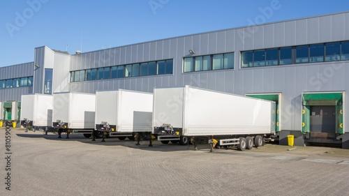 Leinwandbild Motiv Distribution centre with trailers waiting to be loaded