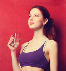 Woman  with water glass after weight loss