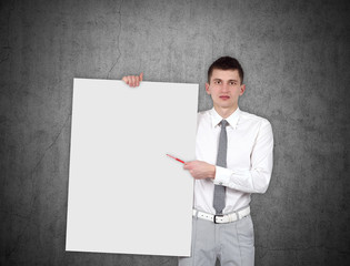 businessman holding blank placard