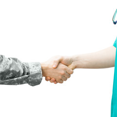 Soldier and doctor shaking hands - studio shot