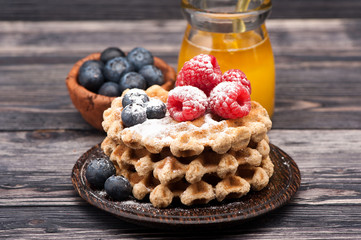 Waffles with berries and honey