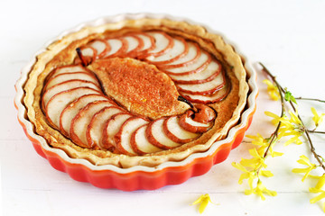 Pie of pears and almond meal baked with cinnamon and marzipan
