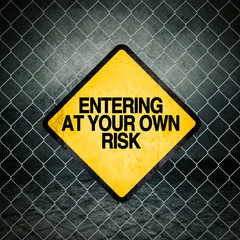 Entering at Your Own Risk Grunge Yellow Warning Sign
