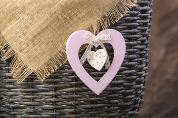 Old Basket with sack cloth and heart decoration