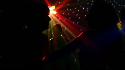 pair dancers dancing in spotlight at the club, silhouette, sexy