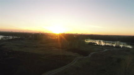 Sunset in  field with  lake. Aerial panorama