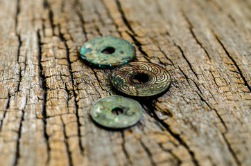 antique coins on wooden background