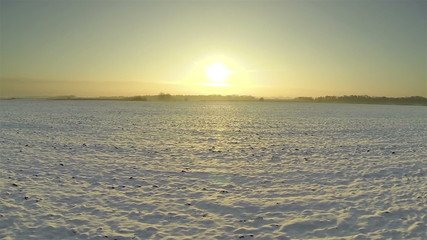 Winter sunrise and snow field  Aerial shot